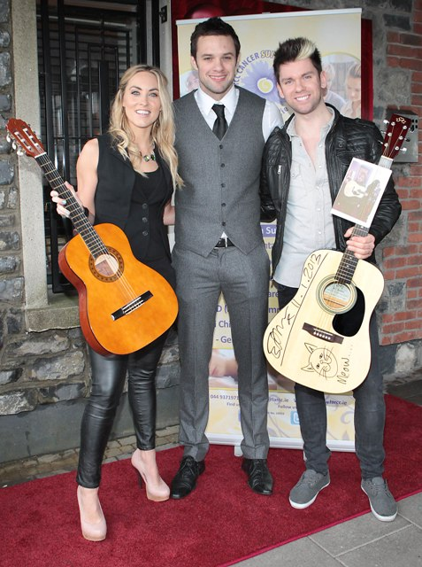 Kathryn Thomas and Eoghan McDermott  pictured with niall Breslin and Guitars donated by Ed Sheeran and  One Directions Niall Horan which were auctionned at Bressies Charity lunch in aid of Larcc Cancer Support in Brasserie 15 Restaurant in Castleknock 